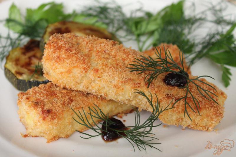 Фото приготовление рецепта: Рыбные палочки в духовке шаг №7