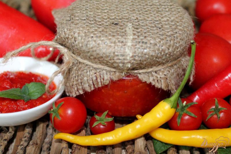 Фото приготовление рецепта: Вареная аджика с яблоками шаг №7