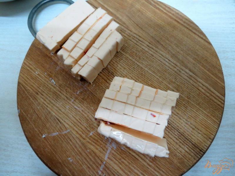 Фото приготовление рецепта: Суп с брюссельской капустой, шампиньонами и сырочком шаг №9