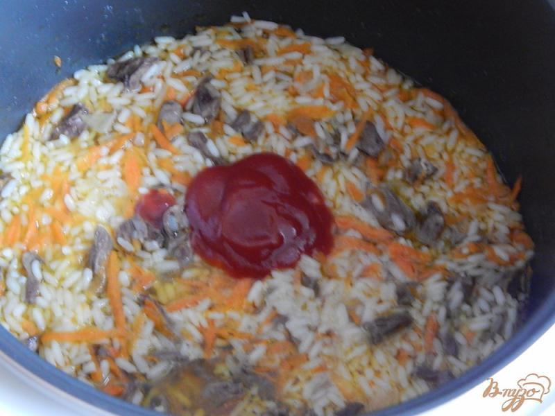 Фото приготовление рецепта: Куриные сердечки с рисом в мультиварке шаг №7