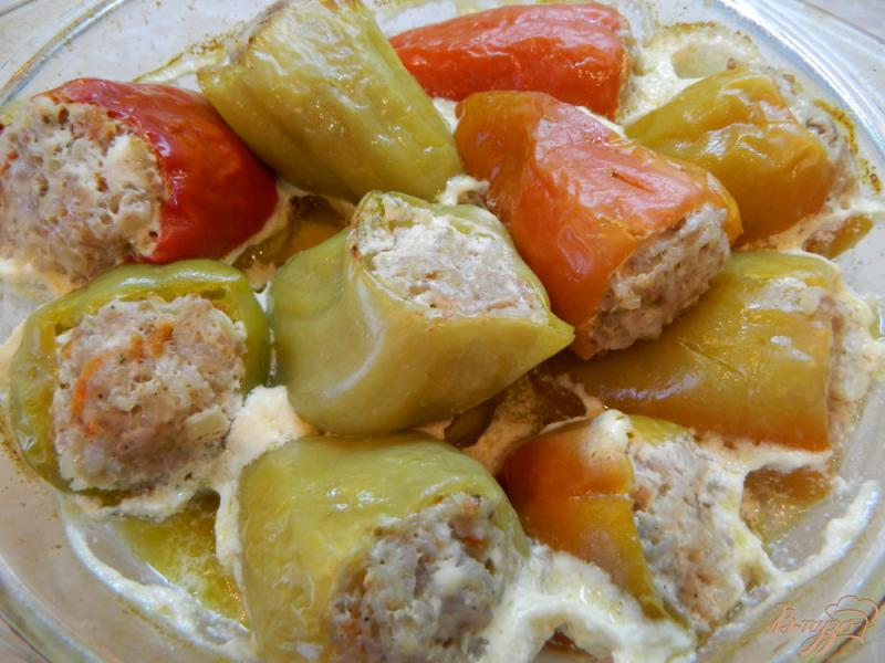Фото приготовление рецепта: Фаршированный перец мясом и рисом, в духовке шаг №9