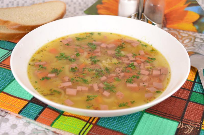 Фото приготовление рецепта: Картофельный суп с колбасой шаг №8