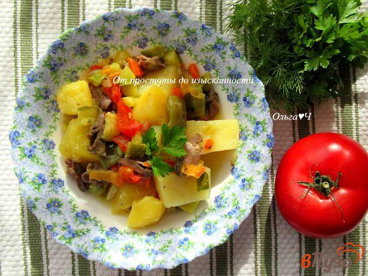 Фото приготовление рецепта: Куриные сердечки с овощами по-гречески (в мультиварке) шаг №7