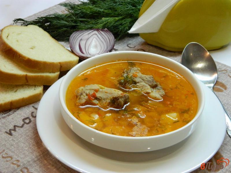 Фото приготовление рецепта: Картофельный суп со свиными ребрышками шаг №6