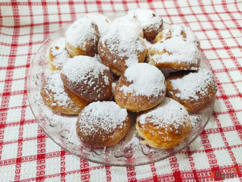 Фото приготовление рецепта: Творожные пончики в духовке шаг №8