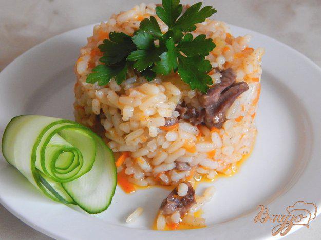 фото рецепта: Куриные сердечки с рисом в мультиварке
