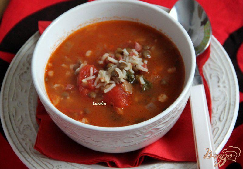 Фото приготовление рецепта: Minestra di riso - итальянский рисовый суп с чечевицей шаг №6