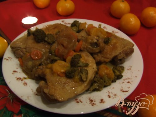Куриные бедрышки с брокколи и мандаринами
