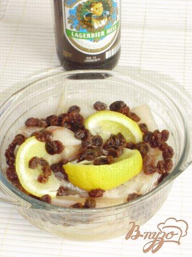 Рыбка, тушенная в пиве, с лимоном и изюмом