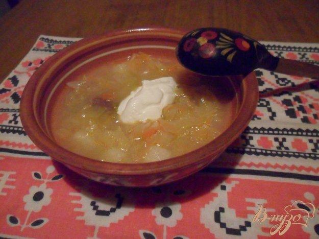 фото рецепта: Щи из квашеной капусты с картофелем