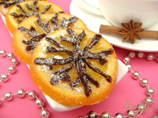 Рецепт Апельсиновые дольки в сиропе с шоколадными снежинками:)))