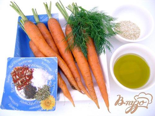 Молодая морковь, обжаренная в оливковом масле со специями