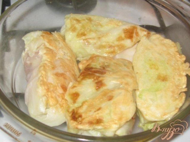 Фото приготовление рецепта: Капустные рулеты с куриным филе шаг №7