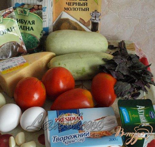 Фото приготовление рецепта: Помидоры с кабачками в сырной заливке шаг №1