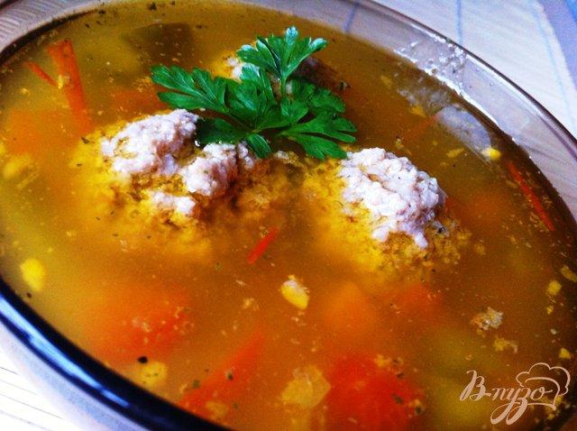 Фото приготовление рецепта: Овощной суп с фрикадельками и рисом шаг №6