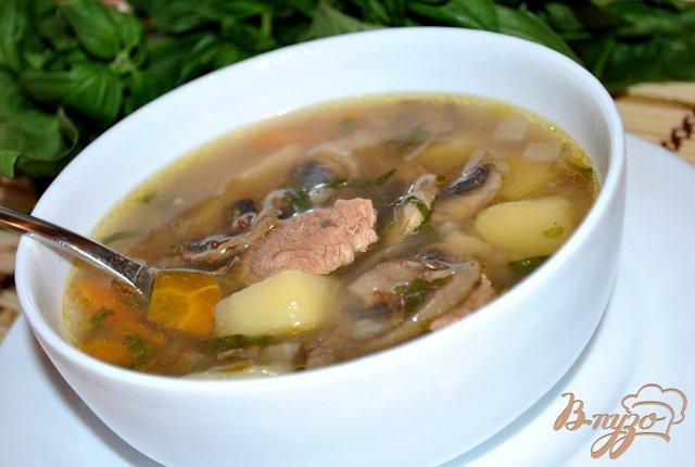 Фото приготовление рецепта: Суп гречневый с грибами шаг №8