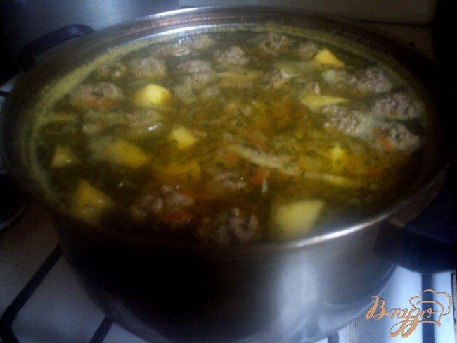 Фото приготовление рецепта: Крестьянский суп с фрикадельками шаг №7