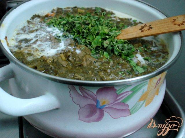 Фото приготовление рецепта: Щавелевый суп с рисом шаг №4