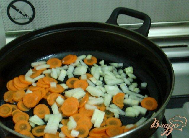 Фото приготовление рецепта: Щавелевый суп с рисом шаг №2