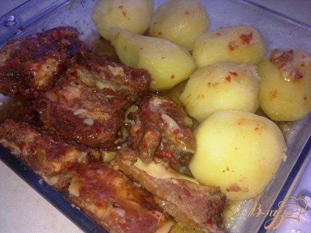 Фото приготовление рецепта: Запеченные ребрышки в остро-сладком маринаде шаг №7