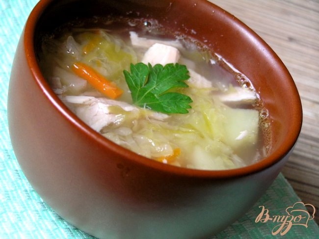 Фото приготовление рецепта: Щи из кислой капусты со свининой шаг №9