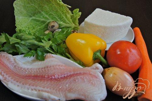 Филе пангасиуса на овощной подложке