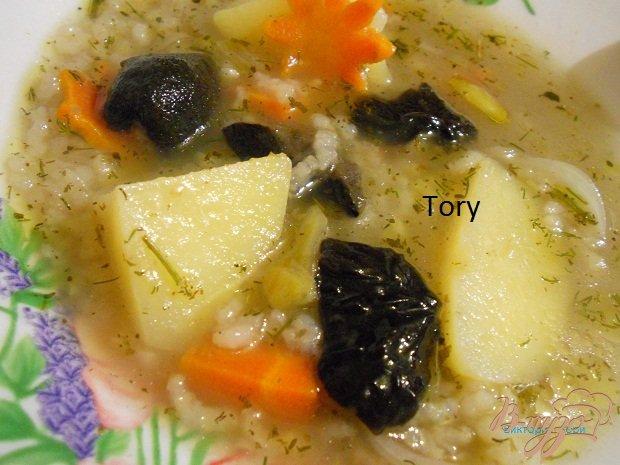 фото рецепта: Рисовый суп с маслятами