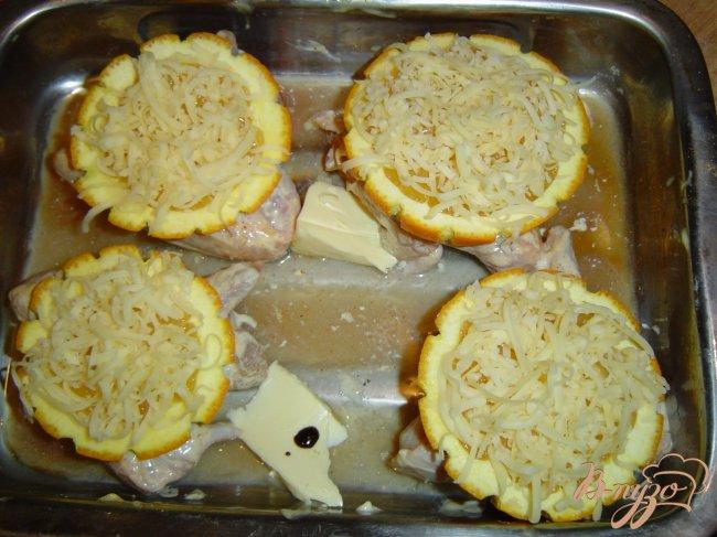 Фото приготовление рецепта: Куриные крылышки под апельсином шаг №7