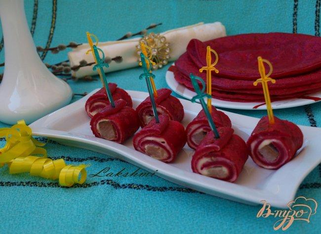 Фото приготовление рецепта: Закуска из свекольных блинчиков с сельдью шаг №7