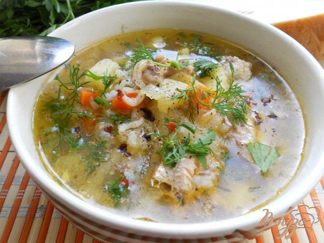 Фото приготовление рецепта: Рыбный суп из консервов шаг №6