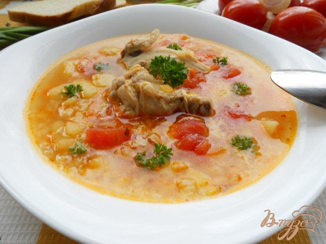 Фото приготовление рецепта: Суп куриный с маринованными помидорами шаг №6