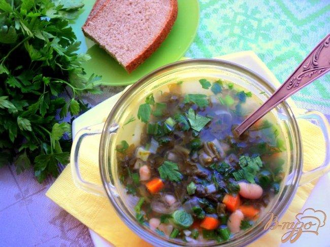 Фото приготовление рецепта: Зеленый борщ с фасолью (постный) шаг №6