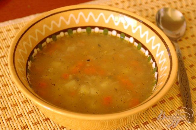 Фото приготовление рецепта: Суп из консервированной скумбрии шаг №6