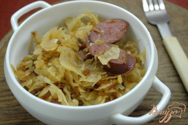 Рецепт Кислая капуста, тушенная с колбасками и тмином
