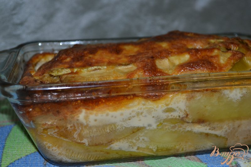 Фото приготовление рецепта: Запеканка из кабачков с фаршем под сливочным соусом шаг №12