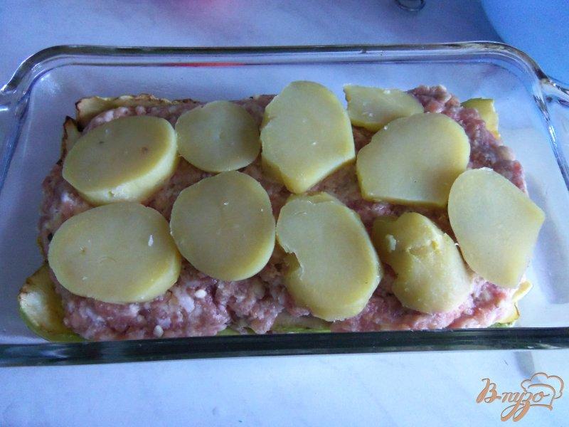 Фото приготовление рецепта: Запеканка из кабачков с фаршем под сливочным соусом шаг №9