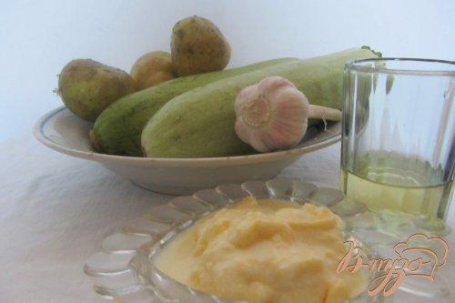 Картофель с кабачками под сметанным соусом.