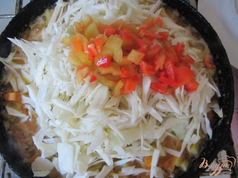 Фото приготовление рецепта: Кабачки тушеные с рисом шаг №10