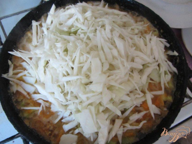Фото приготовление рецепта: Кабачки тушеные с рисом шаг №9