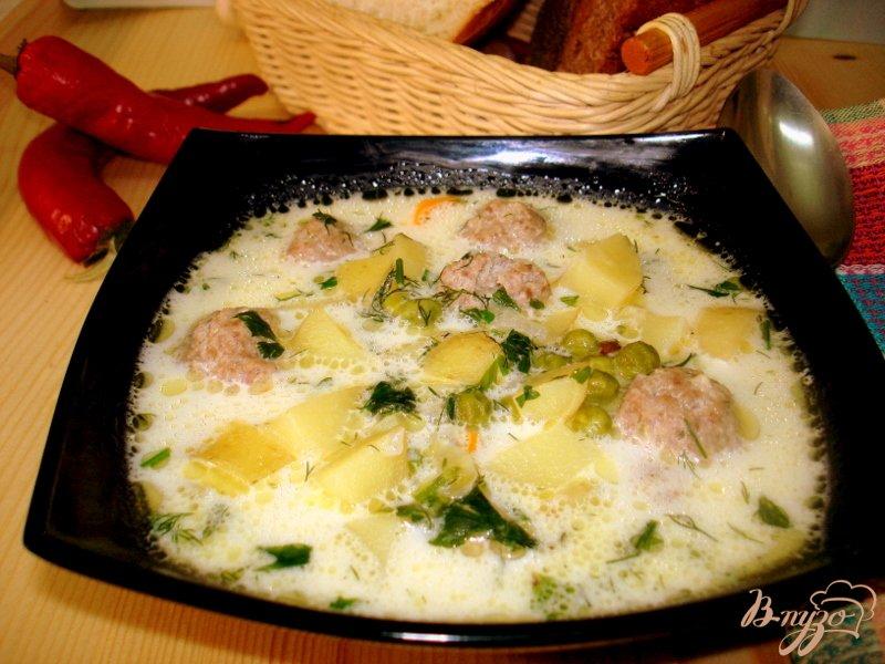 Фото приготовление рецепта: Суп с фрикадельками и сырочками шаг №7
