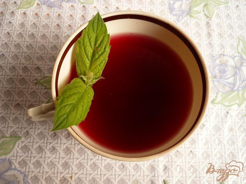 Фото приготовление рецепта: Компот из винограда с мятой шаг №4