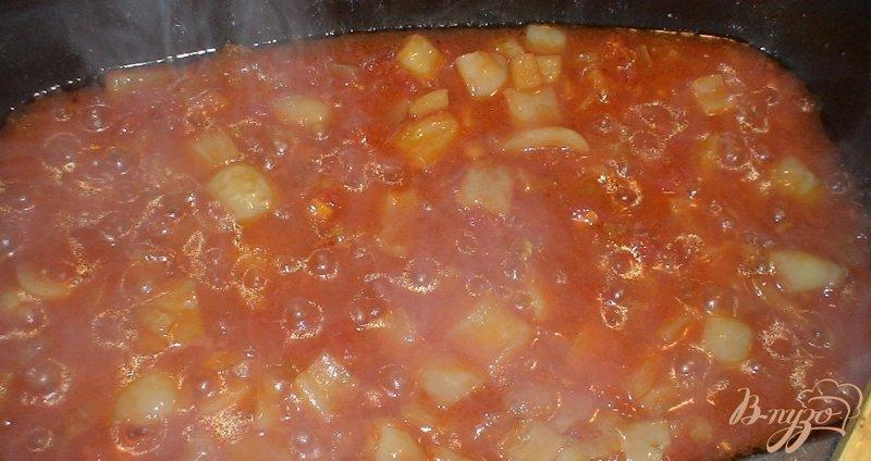 Фото приготовление рецепта: Фрикадельки в соусе шаг №7
