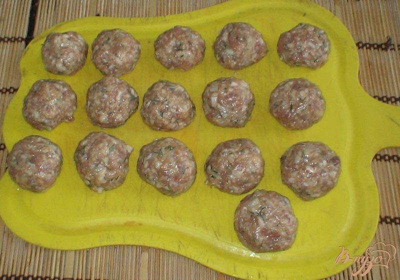 Фото приготовление рецепта: Фрикадельки в соусе шаг №8