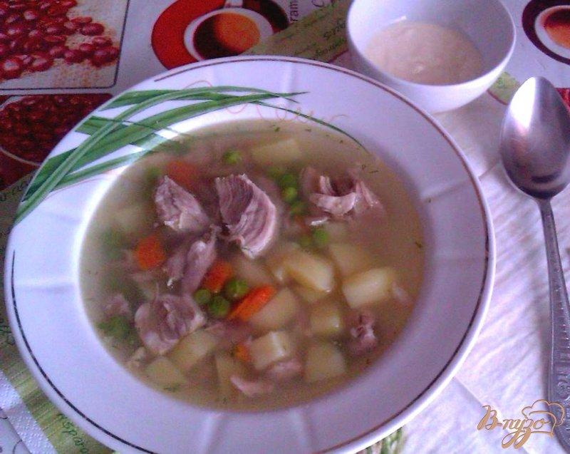 Фото приготовление рецепта: Картофельный суп со свининой и зеленым горошком шаг №7