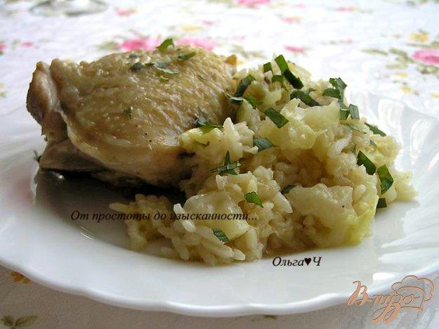 фото рецепта: Куриные бедра с капустой и рисом в мультиварке