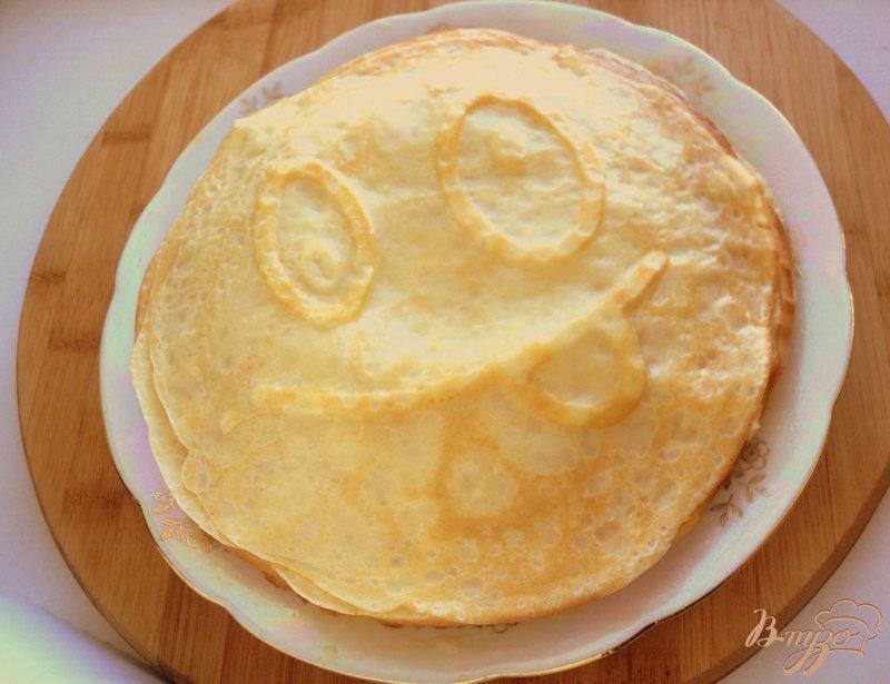 Фото приготовление рецепта: Веселые апельсиновые блины шаг №6