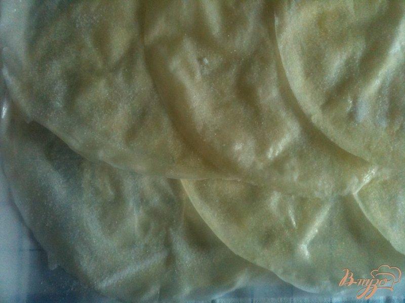 Фото приготовление рецепта: Слоеная улитка с яблоками шаг №6