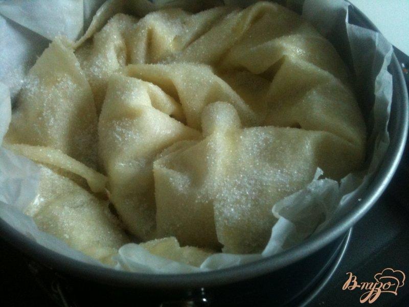 Фото приготовление рецепта: Слоеная улитка с яблоками шаг №10