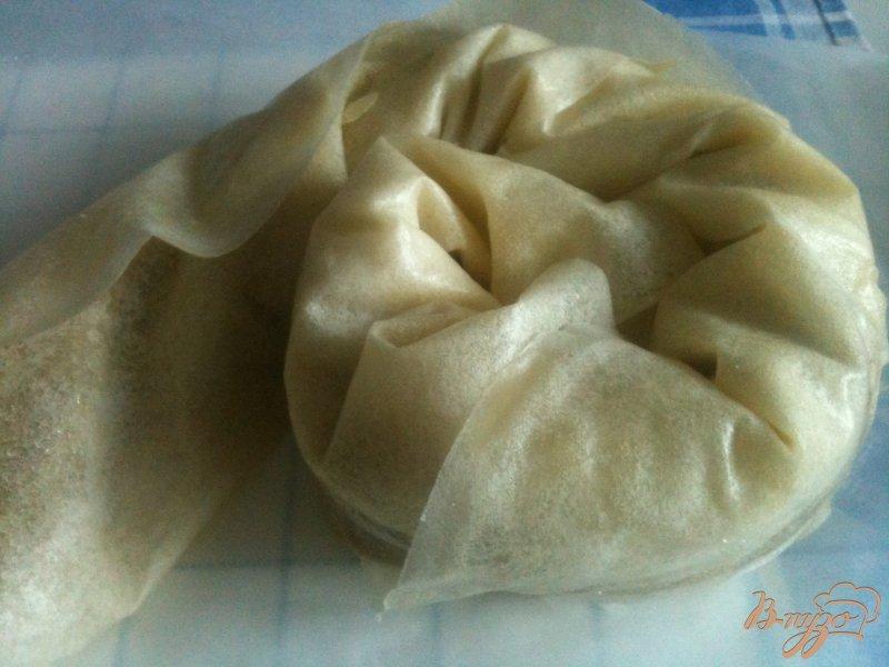 Фото приготовление рецепта: Слоеная улитка с яблоками шаг №9