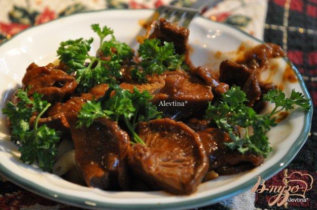 фото рецепта: Тушеная говядина на пиве темном с грибами